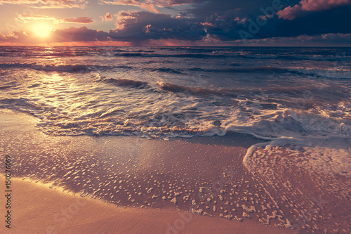 Beatiful sunset with clouds over sea and beach Poster