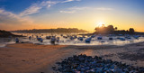 Sailboats at low tide and sunset on the beach of St Briac near St Malo, Brittany, France