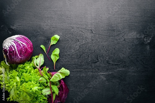 Fresh cabbage and herbs. Top view. On Wooden background.