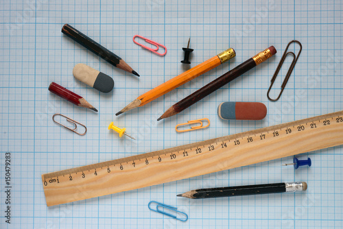 Poster Pencils and wooden ruler.