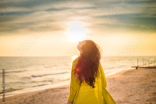 Girl on the background of the sea sunset