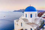 Picturesque view of Old Town Oia on the island Santorini, white houses, windmills and church with blue domes, Greece - 150486618