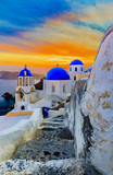 Picturesque view of Old Town Oia on the island Santorini, white houses, windmills and church with blue domes, Greece - 150489418
