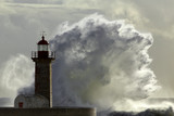Stormy wave against lighthouse