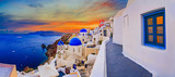 Amazing wide panorama sunset view with white houses on church with blue roofs in Oia village on Santorini island in Greece. - 150516232