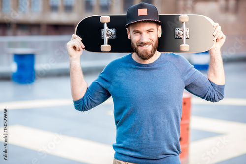 Fotobehang Skateboard Portrait of a man with skateboard
