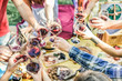 Group of friends enjoying picnic while drinking red wine and eating snack appetizer outdoor