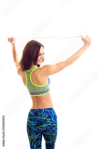 Juliste Sportive woman holding centimeter