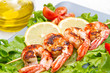 plate of grilled prawns with salad and cherry tomatoes - 150655439