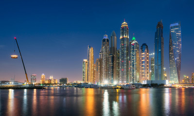 Dubai Marina waterfront from offshore at blue hour. May 2017