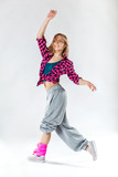Young beautiful slim girl dancing on a white studio background - 150703477