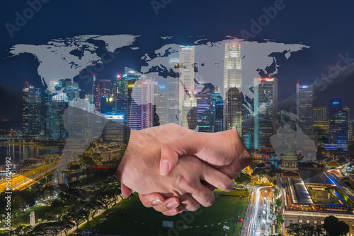 Foto op Aluminium Toronto Double Exposure of a businessman handshake on World Global Cartography Globalization with Cityscape Singapore Panoramic Night Concept