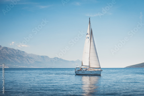 Sailing yacht in the sea against the backdrop of mountains Poster