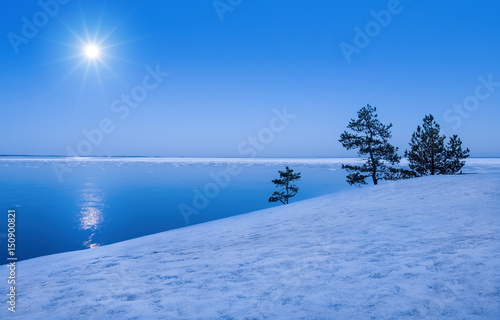 Seascape with moonlight at winter time