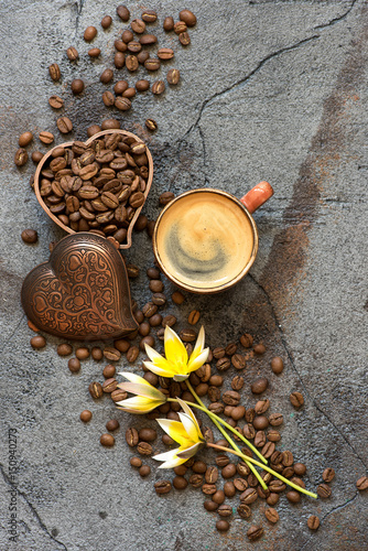 Coffee cup and coffee beans on a gray background. Top view. Poster