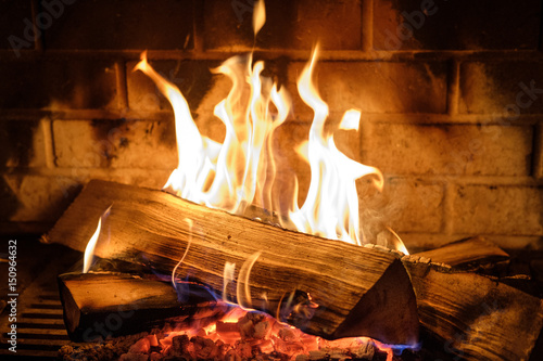 fire burns in the fireplace - 150964632