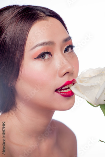 Beautiful asian woman face with perfect makeup with flowers of a rose Poster
