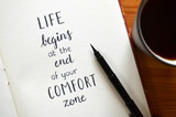 LIFE BEGINS AT THE END OF YOUR COMFORT ZONE written in brush calligraphy on notepad - 151217680