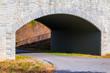 The Piedmont Park Trail and the stone bridge closeup on the Evelyn St NE in autumn day, Atlanta, USA.