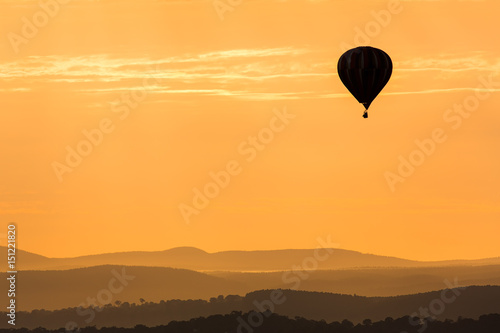 Hot Air Balloon Floating Over The Mountains In The Twilight Poster