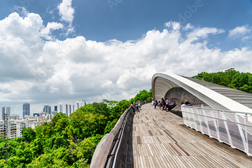 Bridge imitating wave. Wooden walkway leading to park. Singapore Poster