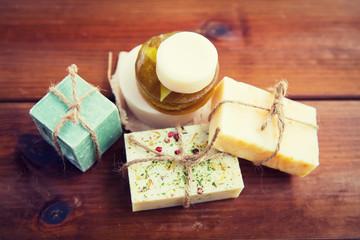 close up of handmade soap bars on wood