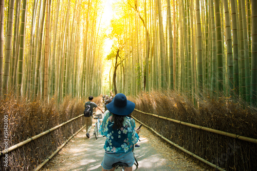Staande foto Kyoto Tourist is cycling for sightseeing at Arashiyama bamboo forest in Kyoto, Japan.