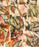 pizza with zucchini eggplant and peppers and many mozzarella che