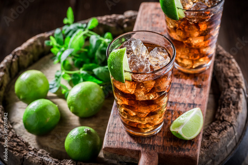 Tasty iced tea with lime and ice