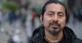 Hispanic Latino man in city face portrait - 151518449