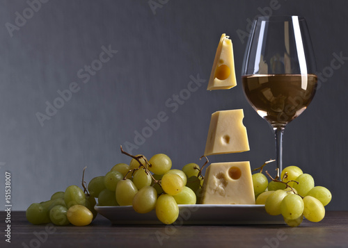 Magic cheese with grape and glass of wine Poster