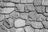 Rough gray stone wall, background texture