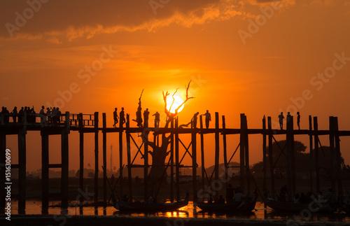 Poster Oranje eclat Beautiful sunset with the silhouette of U Bein bridge, Mandalay region of Myanmar.