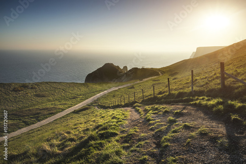 Beautiful sunset landscape image of Durdle Door on Jurassic Coast in England Poster