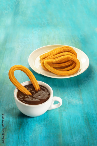 Churros with hot chocolate, traditional Spanish breakfast