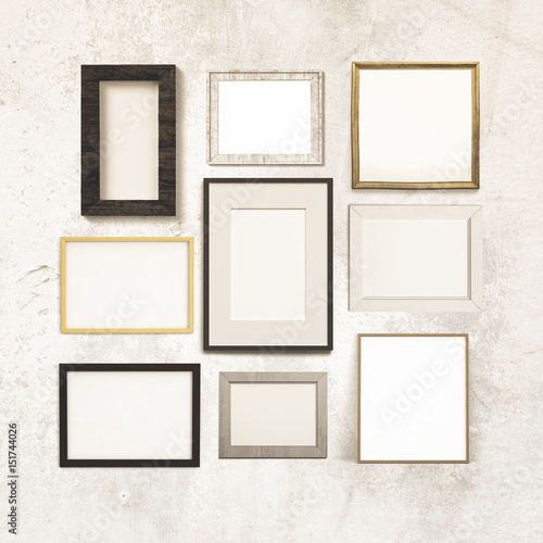 gallery of frames hanging on a grunge wall © reichdernatur