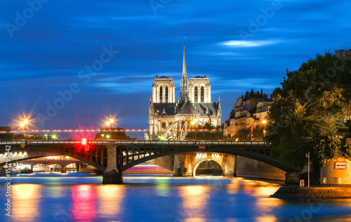 Foto op Canvas Praag The Notre Dame cathedral at night, Paris, France.