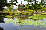 Seoul. The Gyeongbokgung Palace. Pavilion Hyangwonjeong in a beautiful park landscape with a lotus pond on a summer day