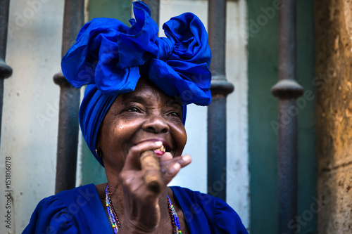 Poster Havana Portrait of african cuban woman smoking cigar in Havana, Cuba