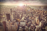 Fototapety New York city skyline, sunrise in background.