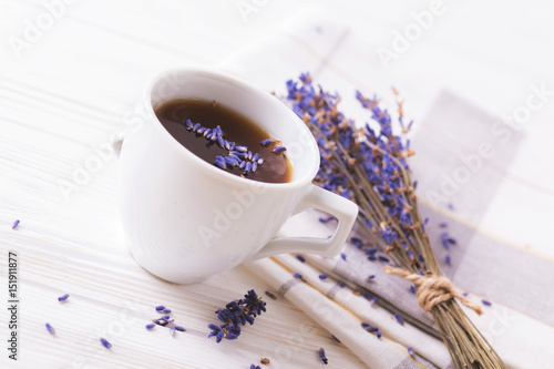 Cup of coffee with lavender flowers on table - 151911877