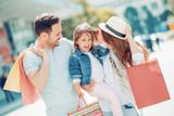 Young family enjoying shopping - 152011024