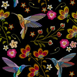 Humming bird and tropical flowers embroidery seamless pattern. Beautiful hummingbirds and exotic flowers embroidery on black background. Template for clothes, textiles, t-shirt design - 152041409