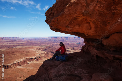 Foto op Plexiglas Bruin Hiker rests in Canyonlands National park in Utah, USA