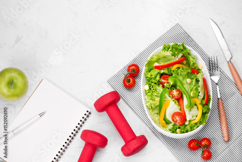 Fototapeta Healthy fitness meal with fresh salad. Diet concept.