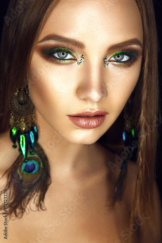 Beautiful woman portrait in american indian style with glamour colorful make up Poster
