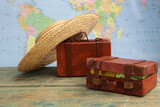 Luggage on world map background. Travel concept