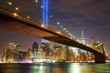 Brooklyn Bridge and Manhattan skyline with light beams