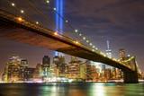 Brooklyn Bridge and Manhattan skyline with light beams