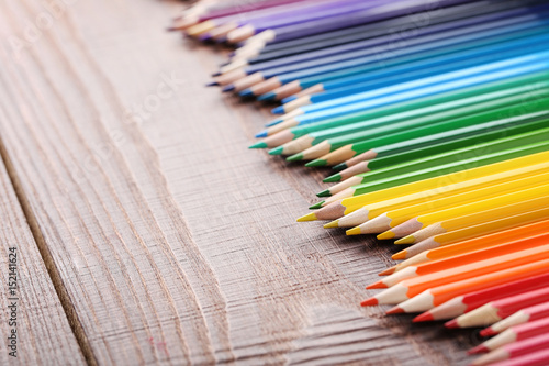 Drawing colourful pencils on brown wooden table Poster